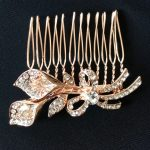 A delightful Rose Gold Trumpet Flower Hair Comb perfect for any special occasion.